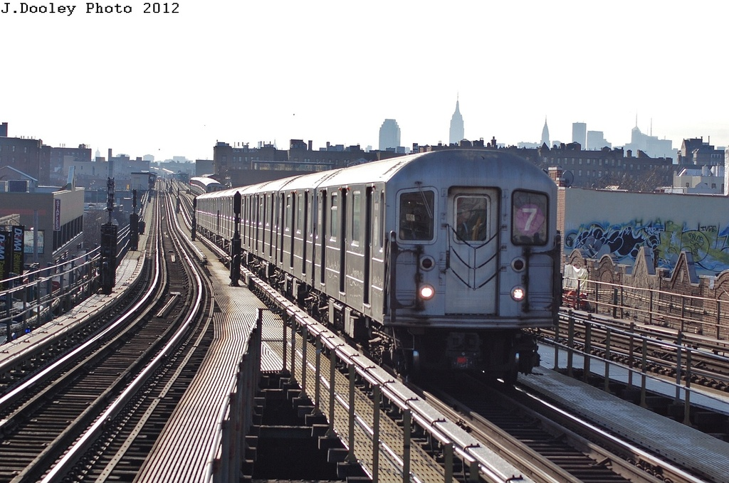 (322k, 1024x679)<br><b>Country:</b> United States<br><b>City:</b> New York<br><b>System:</b> New York City Transit<br><b>Line:</b> IRT Flushing Line<br><b>Location:</b> Junction Boulevard <br><b>Route:</b> 7<br><b>Car:</b> R-62A (Bombardier, 1984-1987)  2154 <br><b>Photo by:</b> John Dooley<br><b>Date:</b> 3/6/2012<br><b>Viewed (this week/total):</b> 1 / 255