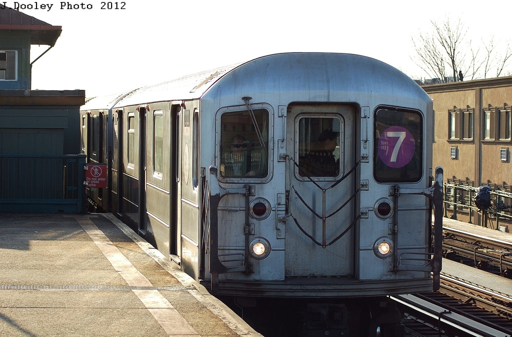 (322k, 1024x675)<br><b>Country:</b> United States<br><b>City:</b> New York<br><b>System:</b> New York City Transit<br><b>Line:</b> IRT Flushing Line<br><b>Location:</b> 103rd Street/Corona Plaza <br><b>Route:</b> 7<br><b>Car:</b> R-62A (Bombardier, 1984-1987)  2212 <br><b>Photo by:</b> John Dooley<br><b>Date:</b> 3/6/2012<br><b>Viewed (this week/total):</b> 9 / 517