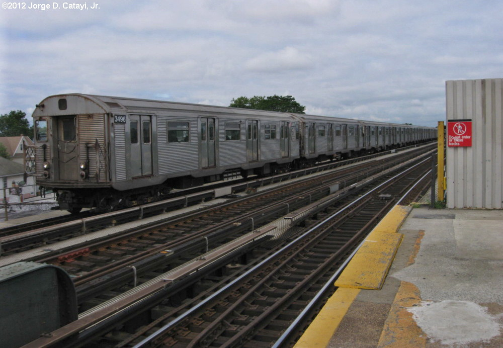 (171k, 1000x692)<br><b>Country:</b> United States<br><b>City:</b> New York<br><b>System:</b> New York City Transit<br><b>Line:</b> IND Fulton Street Line<br><b>Location:</b> Rockaway Boulevard <br><b>Route:</b> A<br><b>Car:</b> R-32 (Budd, 1964)  3496 <br><b>Photo by:</b> Jorge Catayi<br><b>Date:</b> 7/29/2012<br><b>Viewed (this week/total):</b> 2 / 409