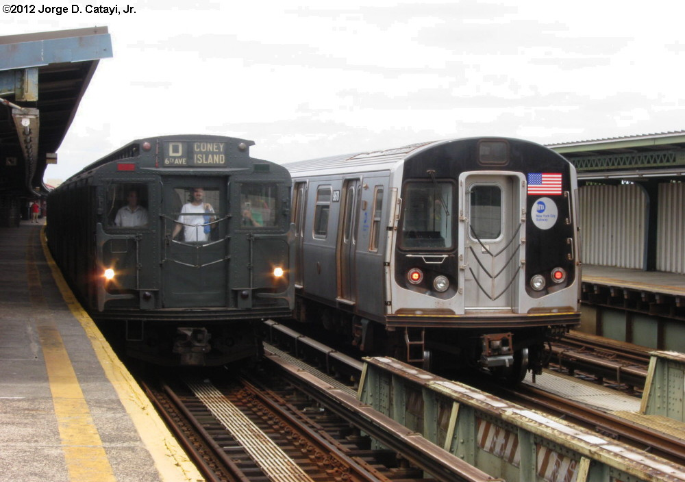 (169k, 1000x704)<br><b>Country:</b> United States<br><b>City:</b> New York<br><b>System:</b> New York City Transit<br><b>Line:</b> BMT Culver Line<br><b>Location:</b> Bay Parkway (22nd Avenue) <br><b>Route:</b> NT<br><b>Car:</b> R-6-1 (Pressed Steel, 1936)  1300 <br><b>Photo by:</b> Jorge Catayi<br><b>Date:</b> 7/29/2012<br><b>Notes:</b> With R-160 9678<br><b>Viewed (this week/total):</b> 12 / 338