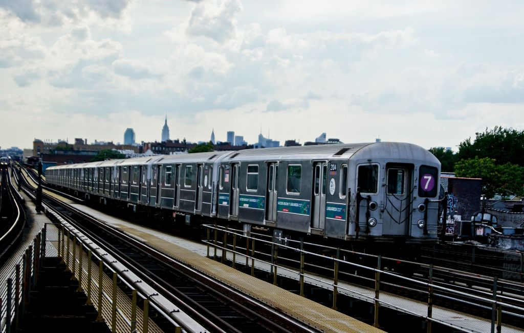 (148k, 1024x652)<br><b>Country:</b> United States<br><b>City:</b> New York<br><b>System:</b> New York City Transit<br><b>Line:</b> IRT Flushing Line<br><b>Location:</b> Junction Boulevard <br><b>Route:</b> 7<br><b>Car:</b> R-62A (Bombardier, 1984-1987)  2104 <br><b>Photo by:</b> Robert Fein<br><b>Date:</b> 6/29/2010<br><b>Viewed (this week/total):</b> 0 / 214