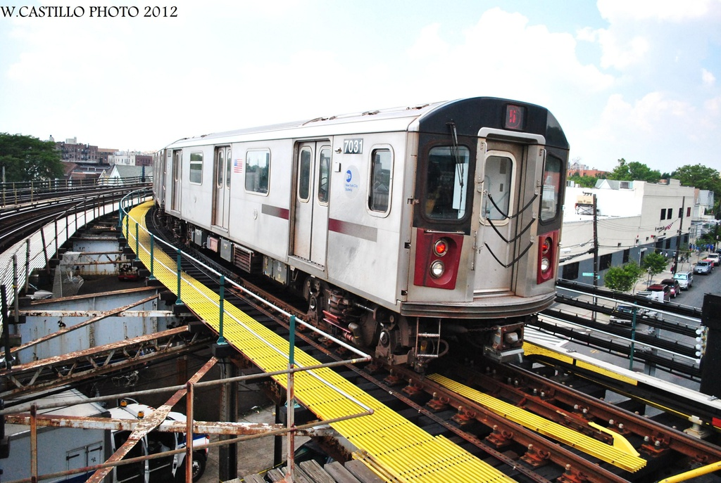 (342k, 1024x687)<br><b>Country:</b> United States<br><b>City:</b> New York<br><b>System:</b> New York City Transit<br><b>Line:</b> IRT White Plains Road Line<br><b>Location:</b> East 180th Street <br><b>Route:</b> 5<br><b>Car:</b> R-142 (Option Order, Bombardier, 2002-2003)  7031 <br><b>Photo by:</b> Wilfredo Castillo<br><b>Date:</b> 8/9/2012<br><b>Viewed (this week/total):</b> 3 / 674