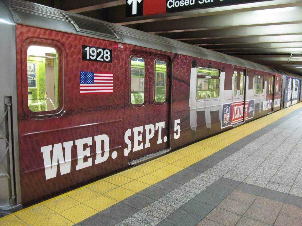 (145k, 1024x768)<br><b>Country:</b> United States<br><b>City:</b> New York<br><b>System:</b> New York City Transit<br><b>Line:</b> IRT Times Square-Grand Central Shuttle<br><b>Location:</b> Grand Central <br><b>Route:</b> S<br><b>Car:</b> R-62A (Bombardier, 1984-1987)  1928 <br><b>Photo by:</b> Robbie Rosenfeld<br><b>Date:</b> 8/27/2012<br><b>Notes:</b> NFL Giants-Cowboys promotion.<br><b>Viewed (this week/total):</b> 0 / 673
