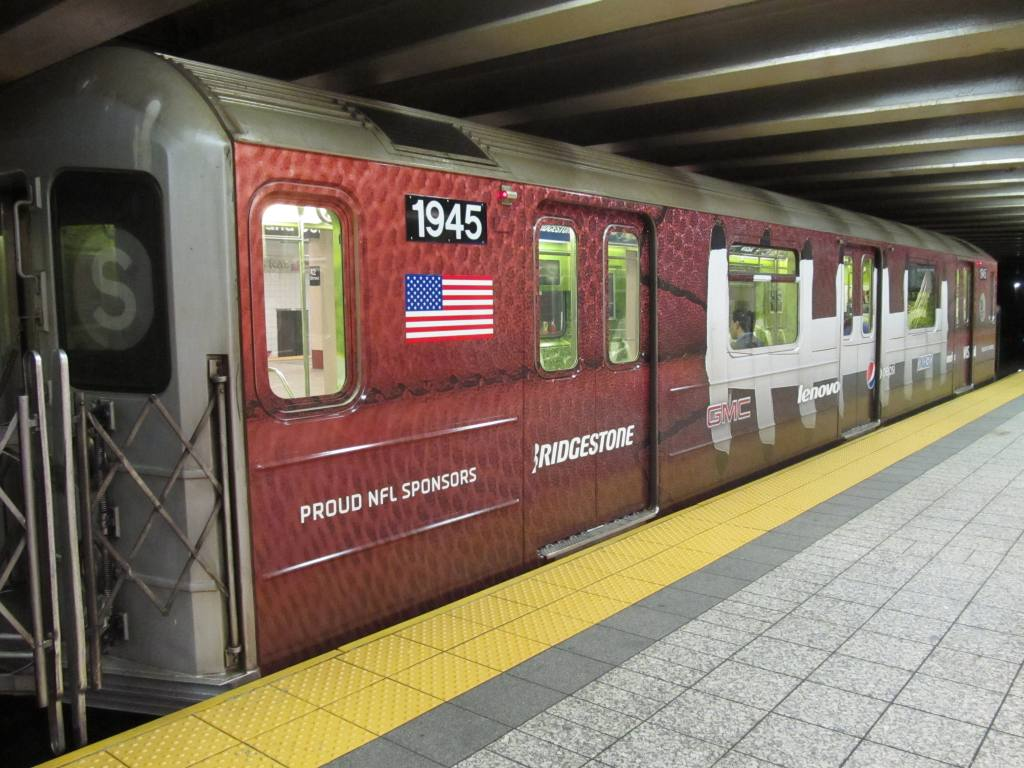 (142k, 1024x768)<br><b>Country:</b> United States<br><b>City:</b> New York<br><b>System:</b> New York City Transit<br><b>Line:</b> IRT Times Square-Grand Central Shuttle<br><b>Location:</b> Grand Central <br><b>Route:</b> S<br><b>Car:</b> R-62A (Bombardier, 1984-1987)  1945 <br><b>Photo by:</b> Robbie Rosenfeld<br><b>Date:</b> 8/27/2012<br><b>Notes:</b> NFL Giants-Cowboys promotion.<br><b>Viewed (this week/total):</b> 5 / 293