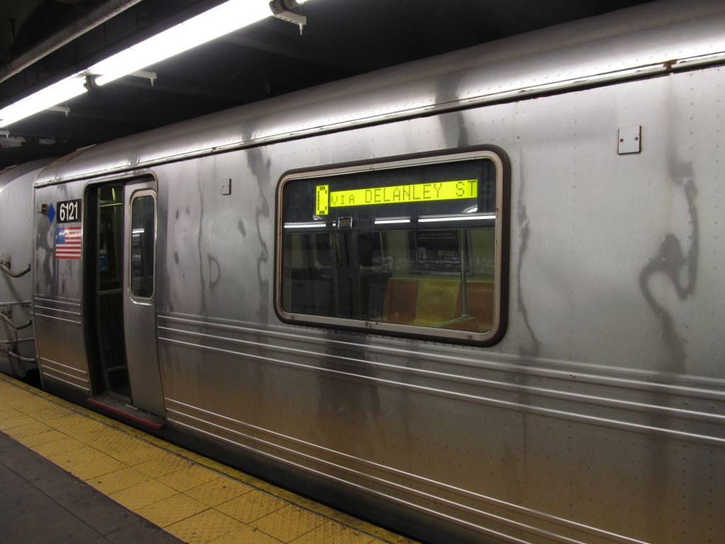 (91k, 1024x768)<br><b>Country:</b> United States<br><b>City:</b> New York<br><b>System:</b> New York City Transit<br><b>Line:</b> IND 8th Avenue Line<br><b>Location:</b> 168th Street <br><b>Route:</b> C<br><b>Car:</b> R-46 (Pullman-Standard, 1974-75) 6121 <br><b>Photo by:</b> Robbie Rosenfeld<br><b>Date:</b> 8/30/2012<br><b>Notes:</b> Note via Delanley Street sign.<br><b>Viewed (this week/total):</b> 8 / 1117
