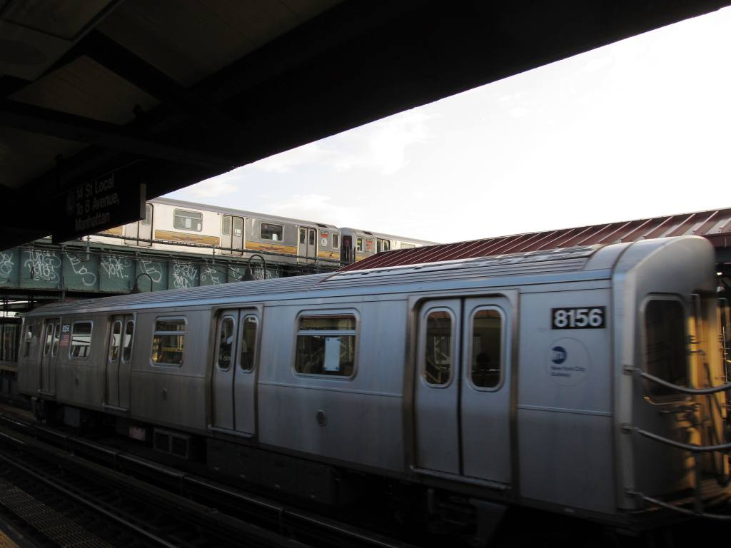 (89k, 1024x768)<br><b>Country:</b> United States<br><b>City:</b> New York<br><b>System:</b> New York City Transit<br><b>Line:</b> BMT Canarsie Line<br><b>Location:</b> Livonia Avenue <br><b>Route:</b> L<br><b>Car:</b> R-143 (Kawasaki, 2001-2002) 8156 <br><b>Photo by:</b> Robbie Rosenfeld<br><b>Date:</b> 8/27/2012<br><b>Notes:</b> With #3 train above.<br><b>Viewed (this week/total):</b> 0 / 614