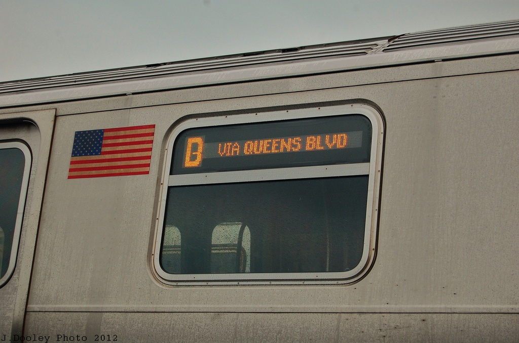(283k, 1024x678)<br><b>Country:</b> United States<br><b>City:</b> New York<br><b>System:</b> New York City Transit<br><b>Location:</b> Coney Island Yard<br><b>Car:</b> R-160A/R-160B Series (Number Unknown)  <br><b>Photo by:</b> John Dooley<br><b>Date:</b> 12/9/2012<br><b>Notes:</b> D via Qns Blvd sign.<br><b>Viewed (this week/total):</b> 0 / 723