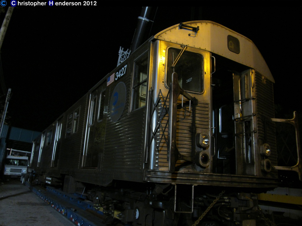 (201k, 1024x768)<br><b>Country:</b> United States<br><b>City:</b> New York<br><b>System:</b> New York City Transit<br><b>Line:</b> IND Rockaway<br><b>Location:</b> Aqueduct Racetrack <br><b>Car:</b> R-32 (Budd, 1964)  3427 <br><b>Photo by:</b> Christopher Henderson<br><b>Date:</b> 11/6/202012<br><b>Notes:</b> Trucking cars to the Rockaways post-Sandy<br><b>Viewed (this week/total):</b> 0 / 248