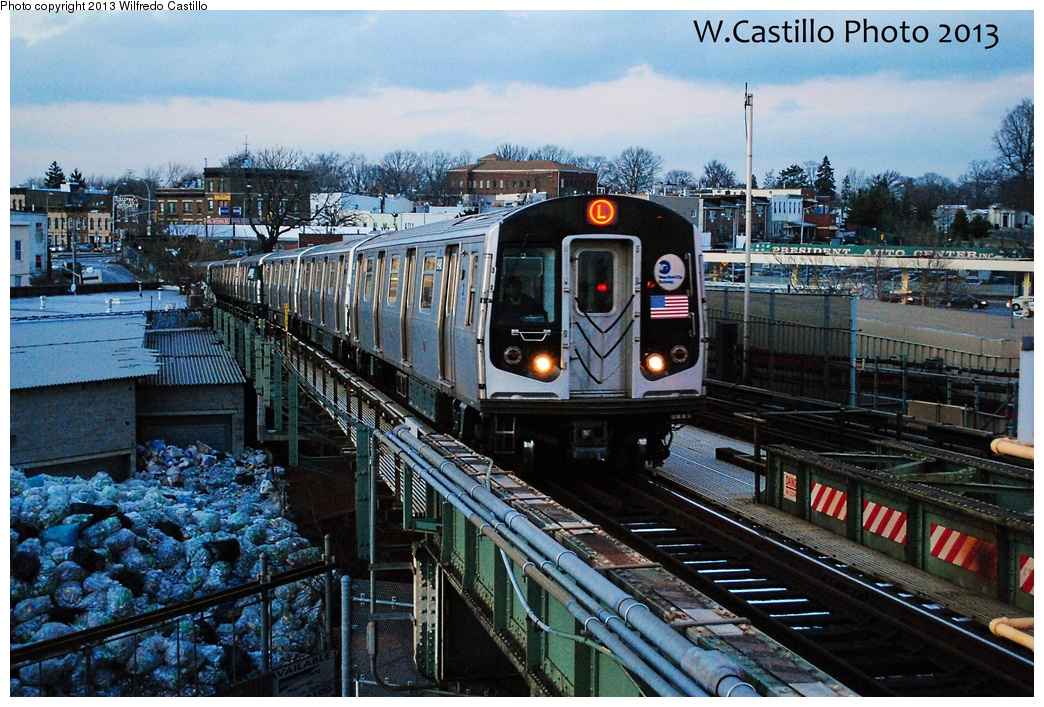 (394k, 1044x707)<br><b>Country:</b> United States<br><b>City:</b> New York<br><b>System:</b> New York City Transit<br><b>Line:</b> BMT Canarsie Line<br><b>Location:</b> Broadway Junction <br><b>Route:</b> L<br><b>Car:</b> R-143 (Kawasaki, 2001-2002) 8148 <br><b>Photo by:</b> Wilfredo Castillo<br><b>Date:</b> 2/3/2013<br><b>Viewed (this week/total):</b> 0 / 489