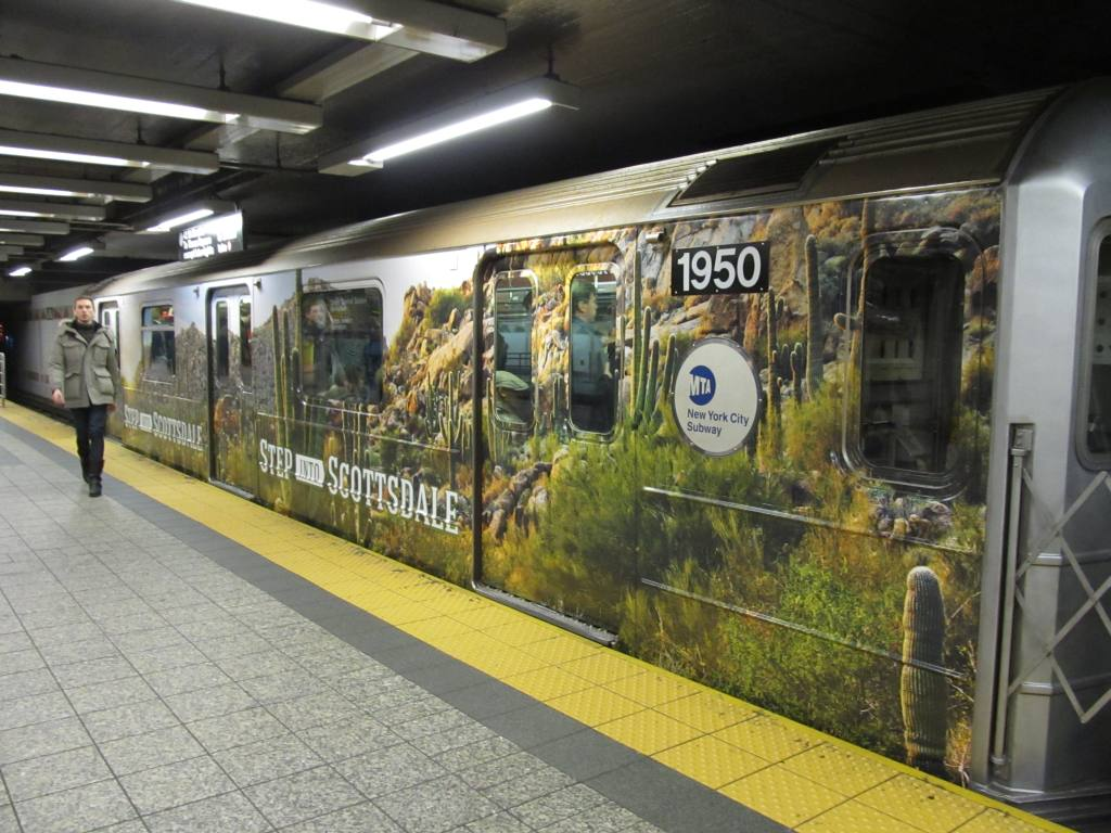 (132k, 1024x768)<br><b>Country:</b> United States<br><b>City:</b> New York<br><b>System:</b> New York City Transit<br><b>Line:</b> IRT Times Square-Grand Central Shuttle<br><b>Location:</b> Grand Central <br><b>Route:</b> S<br><b>Car:</b> R-62A (Bombardier, 1984-1987)  1950 <br><b>Photo by:</b> Robbie Rosenfeld<br><b>Date:</b> 2/6/2013<br><b>Notes:</b> Scottzdale, AZ tourism ad wrap<br><b>Viewed (this week/total):</b> 5 / 409
