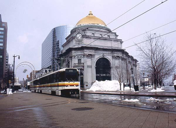 (50k, 600x439)<br><b>Country:</b> United States<br><b>City:</b> Buffalo, NY<br><b>System:</b> NFTA-Metro<br><b>Location:</b> Lafayette Square <br><b>Car:</b>  110 <br><b>Photo by:</b> Rob Hutchinson<br><b>Date:</b> 2/2001<br><b>Notes:</b> Car 110 and mate pass the Buffalo Savings Bank at Lafayette Sq.<br><b>Viewed (this week/total):</b> 4 / 6653