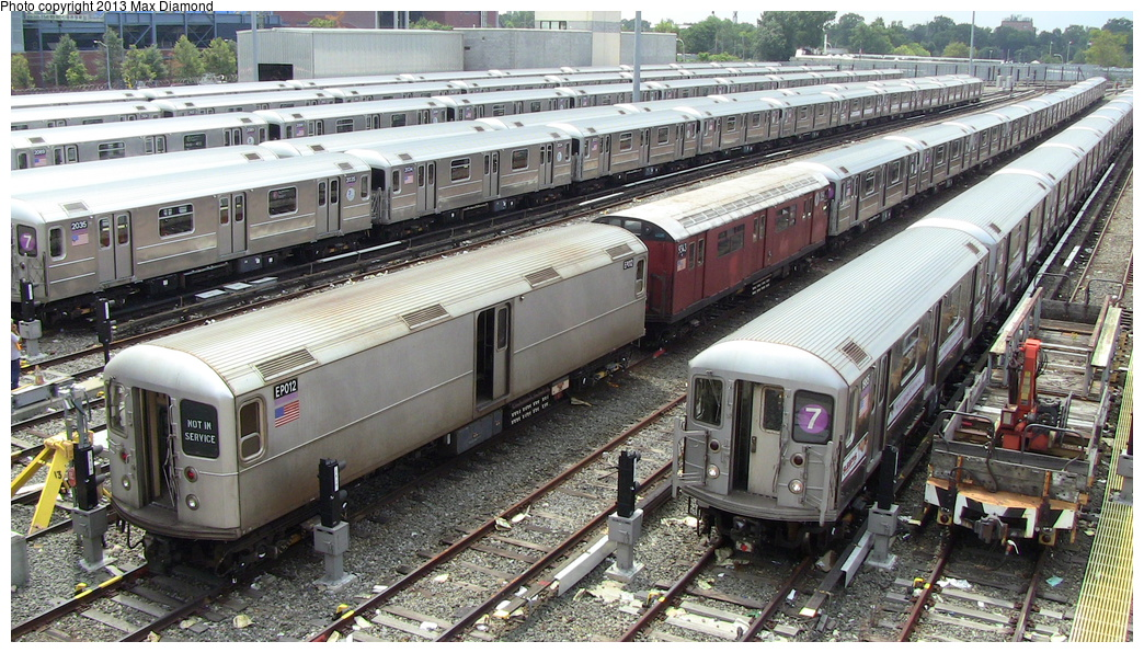 (376k, 1044x596)<br><b>Country:</b> United States<br><b>City:</b> New York<br><b>System:</b> New York City Transit<br><b>Location:</b> Corona Yard<br><b>Car:</b> R-127/R-134 (Kawasaki, 1991-1996) EP012 <br><b>Photo by:</b> Max Diamond<br><b>Date:</b> 8/8/2013<br><b>Viewed (this week/total):</b> 3 / 338