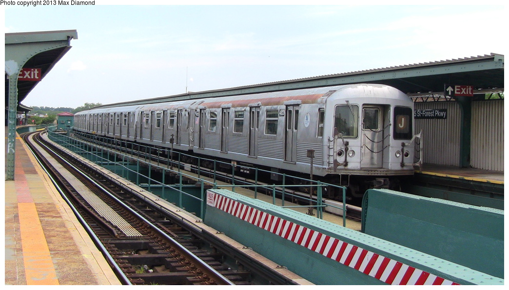 (276k, 1044x596)<br><b>Country:</b> United States<br><b>City:</b> New York<br><b>System:</b> New York City Transit<br><b>Line:</b> BMT Nassau Street/Jamaica Line<br><b>Location:</b> 85th Street/Forest Parkway <br><b>Route:</b> J<br><b>Car:</b> R-42 (St. Louis, 1969-1970)  4823 <br><b>Photo by:</b> Max Diamond<br><b>Date:</b> 7/27/2013<br><b>Viewed (this week/total):</b> 4 / 393