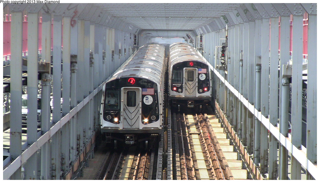 (313k, 1044x596)<br><b>Country:</b> United States<br><b>City:</b> New York<br><b>System:</b> New York City Transit<br><b>Line:</b> BMT Nassau Street/Jamaica Line<br><b>Location:</b> Williamsburg Bridge<br><b>Route:</b> J/M<br><b>Car:</b> R-160A/R-160B Series (Number Unknown)  <br><b>Photo by:</b> Max Diamond<br><b>Date:</b> 7/29/2013<br><b>Viewed (this week/total):</b> 1 / 487