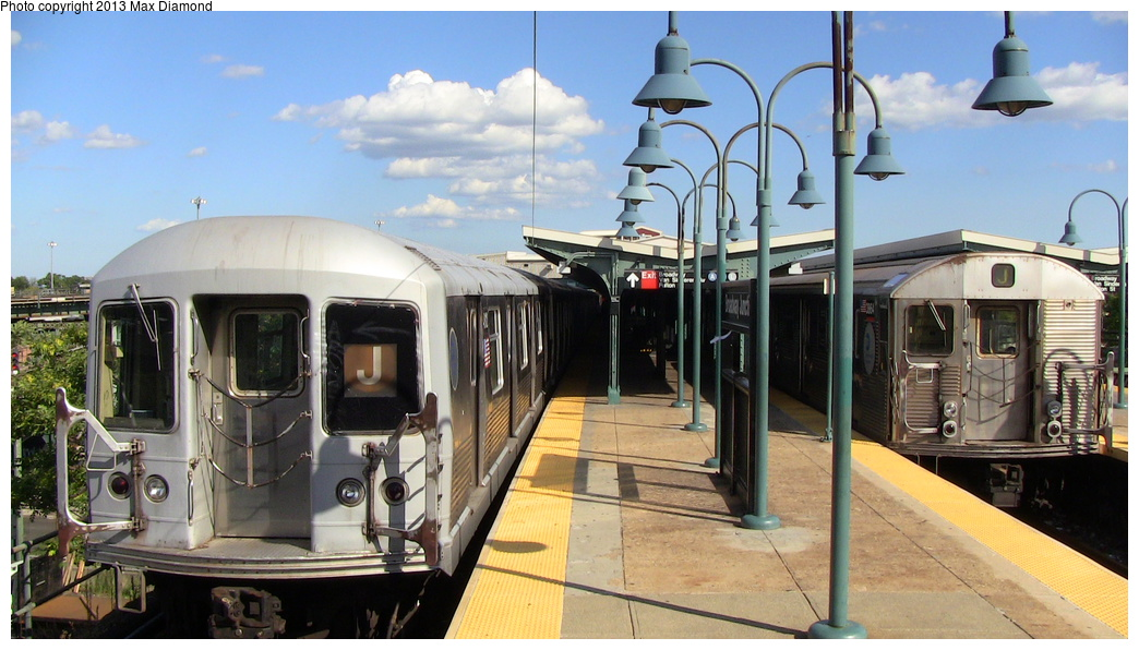 (278k, 1044x596)<br><b>Country:</b> United States<br><b>City:</b> New York<br><b>System:</b> New York City Transit<br><b>Line:</b> BMT Nassau Street/Jamaica Line<br><b>Location:</b> Broadway/East New York (Broadway Junction) <br><b>Route:</b> J<br><b>Car:</b> R-42 (St. Louis, 1969-1970)  4812 <br><b>Photo by:</b> Max Diamond<br><b>Date:</b> 8/4/2013<br><b>Notes:</b> With R32 3864<br><b>Viewed (this week/total):</b> 2 / 389
