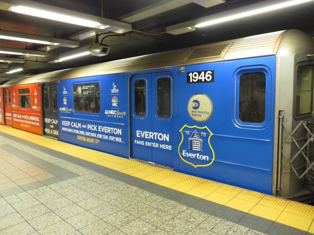 (134k, 1024x768)<br><b>Country:</b> United States<br><b>City:</b> New York<br><b>System:</b> New York City Transit<br><b>Line:</b> IRT Times Square-Grand Central Shuttle<br><b>Location:</b> Grand Central <br><b>Route:</b> S<br><b>Car:</b> R-62A (Bombardier, 1984-1987)  1946 <br><b>Photo by:</b> Robbie Rosenfeld<br><b>Date:</b> 8/11/2013<br><b>Notes:</b> NBC sports soccer wrap.<br><b>Viewed (this week/total):</b> 0 / 389