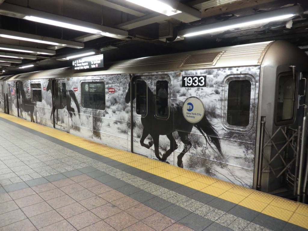 (127k, 1024x768)<br><b>Country:</b> United States<br><b>City:</b> New York<br><b>System:</b> New York City Transit<br><b>Line:</b> IRT Times Square-Grand Central Shuttle<br><b>Location:</b> Grand Central <br><b>Route:</b> S<br><b>Car:</b> R-62A (Bombardier, 1984-1987)  1933 <br><b>Photo by:</b> Robbie Rosenfeld<br><b>Date:</b> 9/15/2013<br><b>Notes:</b> Levis ad wrap<br><b>Viewed (this week/total):</b> 3 / 259