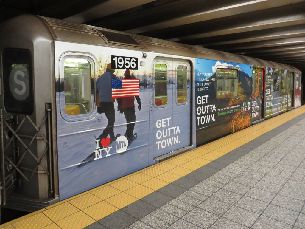 (130k, 1024x768)<br><b>Country:</b> United States<br><b>City:</b> New York<br><b>System:</b> New York City Transit<br><b>Line:</b> IRT Times Square-Grand Central Shuttle<br><b>Location:</b> Grand Central <br><b>Route:</b> S<br><b>Car:</b> R-62A (Bombardier, 1984-1987)  1956 <br><b>Photo by:</b> Robbie Rosenfeld<br><b>Date:</b> 10/20/2013<br><b>Notes:</b> MTA Get Outta Town ad wrap<br><b>Viewed (this week/total):</b> 0 / 359