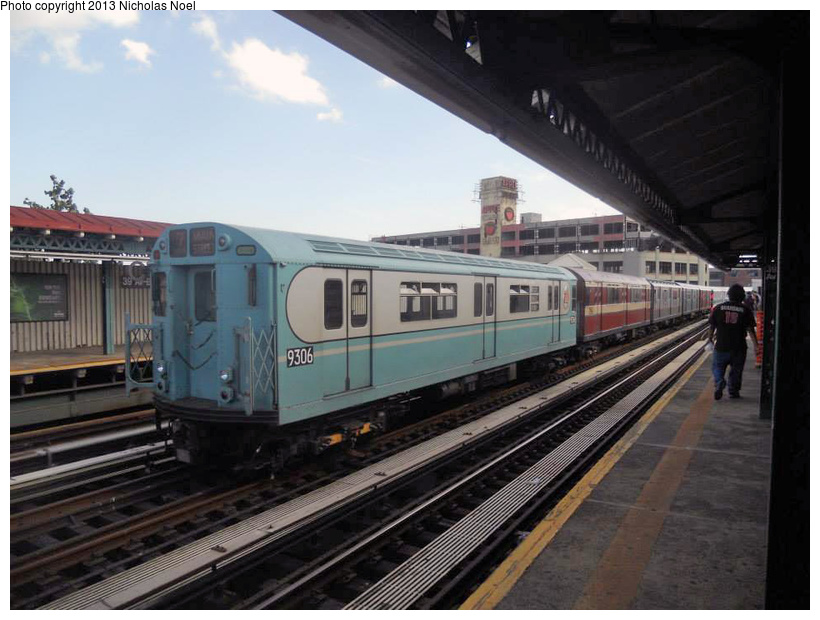 (202k, 820x620)<br><b>Country:</b> United States<br><b>City:</b> New York<br><b>System:</b> New York City Transit<br><b>Line:</b> BMT Astoria Line<br><b>Location:</b> 39th/Beebe Aves. <br><b>Route:</b> Museum Train Service<br><b>Car:</b> R-33 World's Fair (St. Louis, 1963-64) 9306 <br><b>Photo by:</b> Nicholas Noel<br><b>Date:</b> 7/14/2013<br><b>Notes:</b> Yard move from Flushing Line<br><b>Viewed (this week/total):</b> 7 / 955