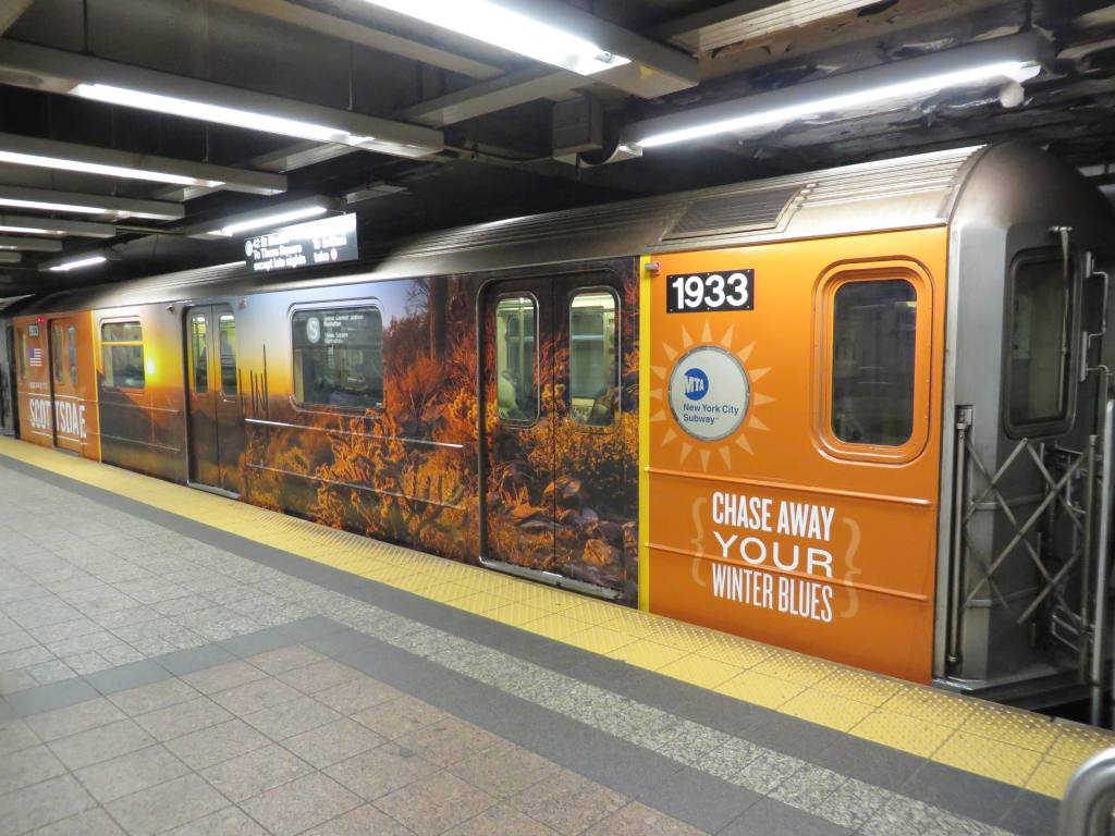 (128k, 1024x768)<br><b>Country:</b> United States<br><b>City:</b> New York<br><b>System:</b> New York City Transit<br><b>Line:</b> IRT Times Square-Grand Central Shuttle<br><b>Location:</b> Grand Central <br><b>Route:</b> S<br><b>Car:</b> R-62A (Bombardier, 1984-1987)  1933 <br><b>Photo by:</b> Robbie Rosenfeld<br><b>Date:</b> 2/12/2014<br><b>Notes:</b> Scottsdale AZ wrap<br><b>Viewed (this week/total):</b> 1 / 440
