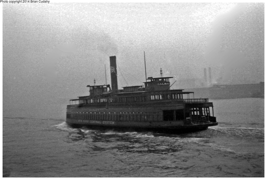 (258k, 1044x703)<br><b>Country:</b> United States<br><b>System:</b> New York Central <br><b>Photo by:</b> Brian J. Cudahy<br><b>Notes:</b> New York Central Railroad's ferryboat Albany crosses the Hudson on another trip from Manhattan to Weehawken.<br><b>Viewed (this week/total):</b> 6 / 714