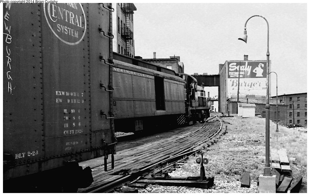 (262k, 1044x660)<br><b>Country:</b> United States<br><b>System:</b> New York Central <br><b>Photo by:</b> Brian J. Cudahy<br><b>Notes:</b> Summer 1955. Two trains operating between Weehawken and Albany meet at Newburg, NY. Both are powered by Alco-GE RS-3 units.<br><b>Viewed (this week/total):</b> 4 / 1435