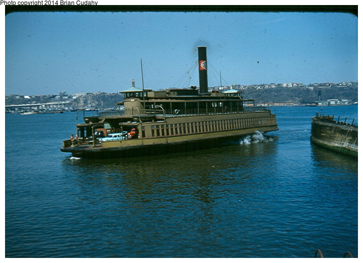 (161k, 720x522)<br><b>Country:</b> United States<br><b>System:</b> New York Central <br><b>Photo by:</b> Brian J. Cudahy<br><b>Notes:</b> New York Central ferryboat Rochester approaches slip at the foot of Manhattan's West 42d Street; summer 1954.<br><b>Viewed (this week/total):</b> 4 / 1577