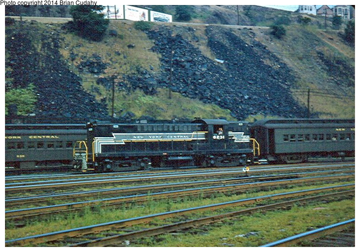 (219k, 720x505)<br><b>Country:</b> United States<br><b>System:</b> New York Central <br><b>Photo by:</b> Brian J. Cudahy<br><b>Notes:</b> NYC Lima-Hamilton road switcher No. 6231 brings a West Shore train into Weehawken; summer 1954.<br><b>Viewed (this week/total):</b> 18 / 1281