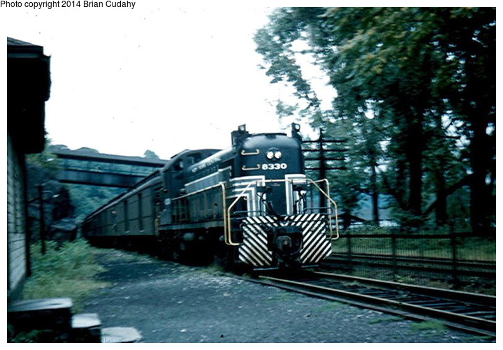 (146k, 720x501)<br><b>Country:</b> United States<br><b>System:</b> New York Central <br><b>Photo by:</b> Brian J. Cudahy<br><b>Notes:</b> An Albany-to-Weehawken train on the West Shore Division pauses to pick up passengers at Bear Mountain. August 30, 1954. <br><b>Viewed (this week/total):</b> 21 / 942