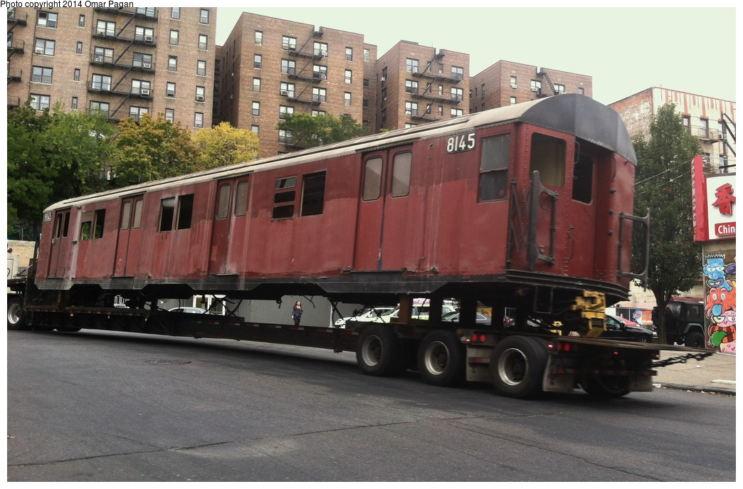 (297k, 1044x687)<br><b>Country:</b> United States<br><b>City:</b> New York<br><b>System:</b> New York City Transit<br><b>Location:</b> 207th Street Yard<br><b>Car:</b> R-27 (St. Louis, 1960)  8145 <br><b>Photo by:</b> Omar Pagan<br><b>Date:</b> 10/22/2013<br><b>Notes:</b> Departing 207th St yard at 215th Street and 10th Avenue. Being sent to scrap to SIMS Metal Management in Newark, New Jersey.<br><b>Viewed (this week/total):</b> 1 / 812