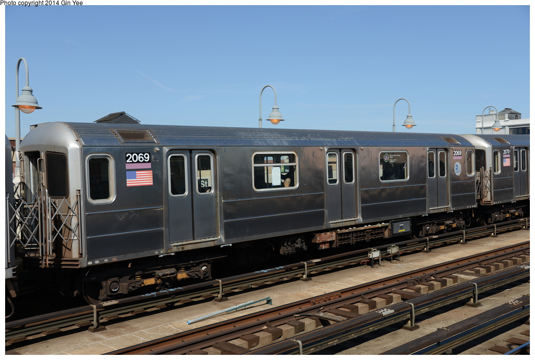 (320k, 1044x703)<br><b>Country:</b> United States<br><b>City:</b> New York<br><b>System:</b> New York City Transit<br><b>Line:</b> IRT Flushing Line<br><b>Location:</b> 33rd Street/Rawson Street <br><b>Route:</b> 7<br><b>Car:</b> R-62A (Bombardier, 1984-1987)  2069 <br><b>Photo by:</b> Gin Yee<br><b>Date:</b> 4/10/2014<br><b>Viewed (this week/total):</b> 0 / 222