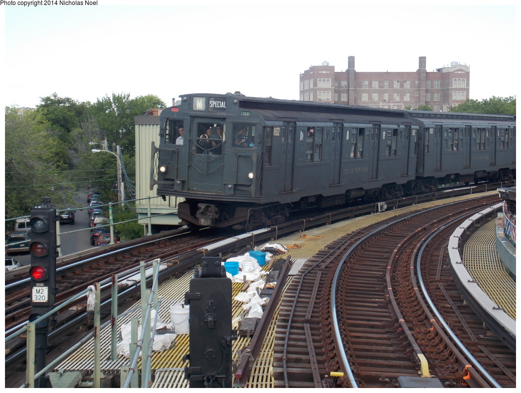 (391k, 1044x788)<br><b>Country:</b> United States<br><b>City:</b> New York<br><b>System:</b> New York City Transit<br><b>Line:</b> BMT Myrtle Avenue Line<br><b>Location:</b> Seneca Avenue <br><b>Route:</b> Museum Train Service (M)<br><b>Car:</b> R-9 (Pressed Steel, 1940)  1802 <br><b>Photo by:</b> Nicholas Noel<br><b>Date:</b> 6/7/2014<br><b>Viewed (this week/total):</b> 1 / 812