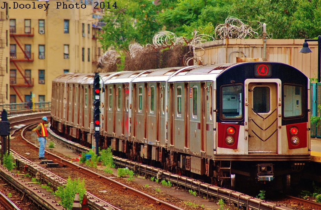 (441k, 1024x670)<br><b>Country:</b> United States<br><b>City:</b> New York<br><b>System:</b> New York City Transit<br><b>Line:</b> IRT Woodlawn Line<br><b>Location:</b> Bedford Park Boulevard <br><b>Route:</b> 4<br><b>Car:</b> R-142A (Option Order, Kawasaki, 2002-2003)  7716 <br><b>Photo by:</b> John Dooley<br><b>Date:</b> 6/19/2014<br><b>Viewed (this week/total):</b> 0 / 568