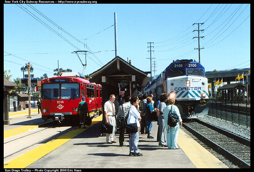 (179k, 824x558)<br><b>Country:</b> United States<br><b>City:</b> San Diego, CA<br><b>System:</b> San Diego Trolley<br><b>Line:</b> San Diego Trolley-Blue Line<br><b>Location:</b> Old Town <br><b>Car:</b> Siemens U2  1014 <br><b>Photo by:</b> Eric Haas<br><b>Date:</b> 7/19/2000<br><b>Notes:</b> The trolley on the left will return to the border. The Coaster train is going to Oceanside.<br><b>Viewed (this week/total):</b> 2 / 3580