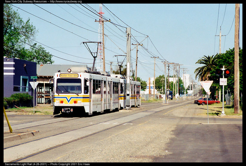 (157k, 824x557)<br><b>Country:</b> United States<br><b>City:</b> Sacramento, CA<br><b>System:</b> SACRT Light Rail<br><b>Location:</b> 23rd Street <br><b>Photo by:</b> Eric Haas<br><b>Date:</b> 4/28/2001<br><b>Notes:</b> Train about the leave single track Bee Bridge.  The Sacramento Bee Building is at the right.<br><b>Viewed (this week/total):</b> 0 / 1664