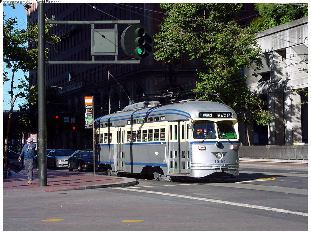 (316k, 1044x788)<br><b>Country:</b> United States<br><b>City:</b> San Francisco/Bay Area, CA<br><b>System:</b> SF MUNI<br><b>Location:</b> Market/Drumm/California <br><b>Route:</b> F-Market<br><b>Car:</b> SF MUNI PCC (Ex-SEPTA) (St. Louis Car Co., 1947-1948)  1054 <br><b>Photo by:</b> David Pirmann<br><b>Date:</b> 7/6/2002<br><b>Viewed (this week/total):</b> 3 / 3515