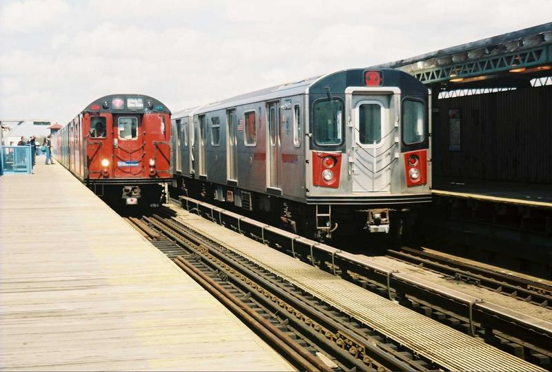 (74k, 800x540)<br><b>Country:</b> United States<br><b>City:</b> New York<br><b>System:</b> New York City Transit<br><b>Line:</b> IRT White Plains Road Line<br><b>Location:</b> 238th Street (Nereid Avenue) <br><b>Route:</b> Fan Trip<br><b>Car:</b> R-33 World's Fair (St. Louis, 1963-64) 9327 <br><b>Photo by:</b> Gary Chatterton<br><b>Date:</b> 5/1/2005<br><b>Notes:</b> With R142 6435<br><b>Viewed (this week/total):</b> 2 / 3580