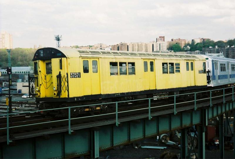 (60k, 800x540)<br><b>Country:</b> United States<br><b>City:</b> New York<br><b>System:</b> New York City Transit<br><b>Location:</b> 207th Street Yard<br><b>Route:</b> Fan Trip<br><b>Car:</b> R-22 (St. Louis, 1957-58) 37371 <br><b>Photo by:</b> Gary Chatterton<br><b>Date:</b> 5/1/2005<br><b>Notes:</b> Work Motor 37371 on fantrip.<br><b>Viewed (this week/total):</b> 1 / 2216