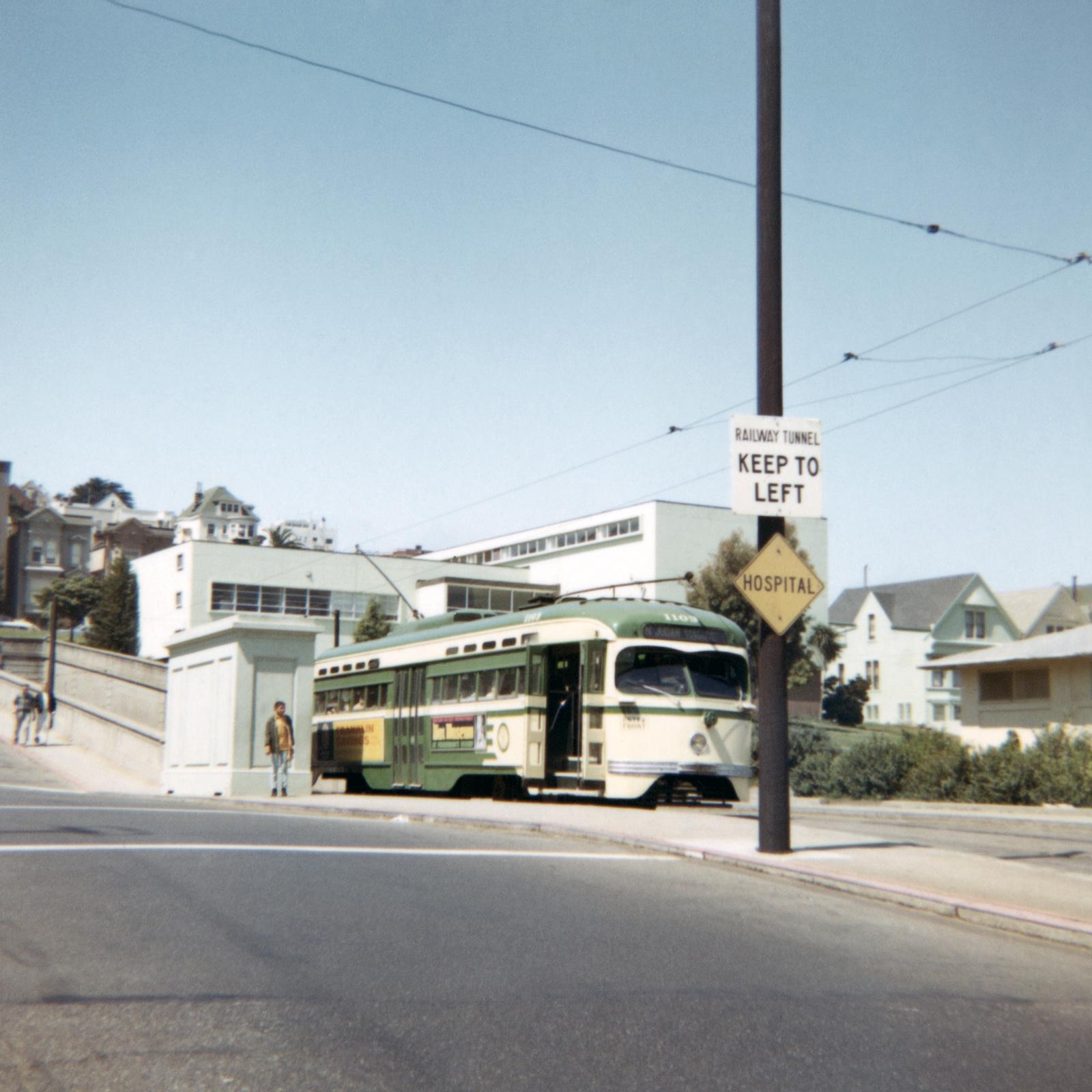 (449k, 1041x1044)<br><b>Country:</b> United States<br><b>City:</b> San Francisco/Bay Area, CA<br><b>System:</b> SF MUNI<br><b>Line:</b> MUNI Metro (N-Judah)<br><b>Location:</b> Sunset Tunnel East Portal <br><b>Route:</b> N-Judah<br><b>Car:</b> SF MUNI PCC St. Louis (St. Louis Car Co, 1946)  1103 <br><b>Photo by:</b> Roberta Hill<br><b>Collection of:</b> David Pirmann<br><b>Date:</b> 8/26/1967<br><b>Viewed (this week/total):</b> 1 / 2589
