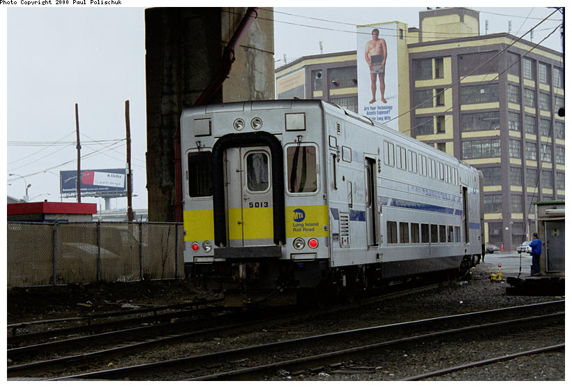 (91k, 820x556)<br><b>Country:</b> United States<br><b>City:</b> New York<br><b>System:</b> Long Island Rail Road<br><b>Line:</b> LIRR Long Island City<br><b>Location:</b> Long Island City <br><b>Car:</b> LIRR Kawasaki C-3/C-R (Bilevel Coach/Cab) 5013 <br><b>Photo by:</b> Paul Polischuk<br><b>Date:</b> 5/2000<br><b>Viewed (this week/total):</b> 2 / 3237