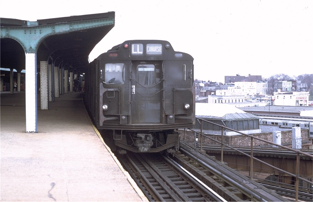 (161k, 1024x661)<br><b>Country:</b> United States<br><b>City:</b> New York<br><b>System:</b> New York City Transit<br><b>Line:</b> BMT Canarsie Line<br><b>Location:</b> Broadway Junction <br><b>Route:</b> L<br><b>Car:</b> R-7A (Pullman, 1938)  1575 <br><b>Photo by:</b> Doug Grotjahn<br><b>Collection of:</b> Joe Testagrose<br><b>Date:</b> 4/10/1971<br><b>Notes:</b> R10 prototype<br><b>Viewed (this week/total):</b> 0 / 2847