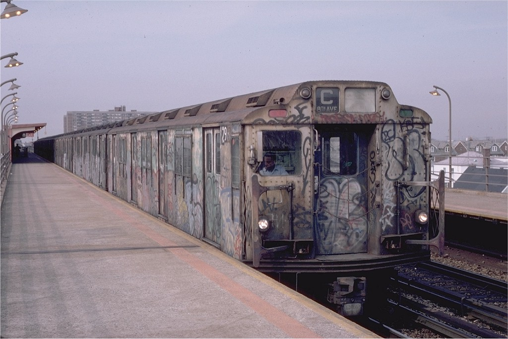 (175k, 1024x683)<br><b>Country:</b> United States<br><b>City:</b> New York<br><b>System:</b> New York City Transit<br><b>Line:</b> IND Rockaway<br><b>Location:</b> Beach 90th Street/Holland <br><b>Route:</b> C<br><b>Car:</b> R-10 (American Car & Foundry, 1948) 2977 (ex-1830)<br><b>Photo by:</b> Eric Oszustowicz<br><b>Collection of:</b> Joe Testagrose<br><b>Date:</b> 4/2/1987<br><b>Viewed (this week/total):</b> 2 / 5177