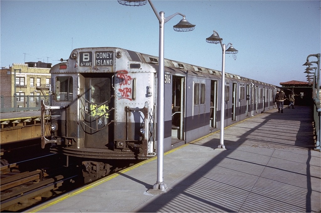 (214k, 1024x682)<br><b>Country:</b> United States<br><b>City:</b> New York<br><b>System:</b> New York City Transit<br><b>Line:</b> BMT West End Line<br><b>Location:</b> 55th Street <br><b>Route:</b> B<br><b>Car:</b> R-10 (American Car & Foundry, 1948) 3116 <br><b>Photo by:</b> Doug Grotjahn<br><b>Collection of:</b> Joe Testagrose<br><b>Date:</b> 11/29/1974<br><b>Viewed (this week/total):</b> 2 / 3267