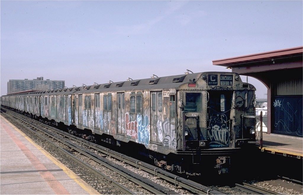 (188k, 1024x659)<br><b>Country:</b> United States<br><b>City:</b> New York<br><b>System:</b> New York City Transit<br><b>Line:</b> IND Rockaway<br><b>Location:</b> Beach 90th Street/Holland <br><b>Route:</b> C<br><b>Car:</b> R-10 (American Car & Foundry, 1948) 3302 <br><b>Photo by:</b> Eric Oszustowicz<br><b>Collection of:</b> Joe Testagrose<br><b>Date:</b> 4/3/1987<br><b>Viewed (this week/total):</b> 2 / 5428