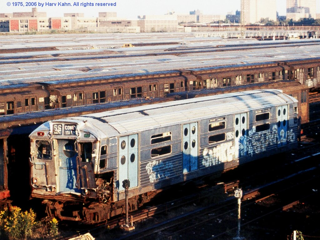 (227k, 1024x768)<br><b>Country:</b> United States<br><b>City:</b> New York<br><b>System:</b> New York City Transit<br><b>Location:</b> Coney Island Yard<br><b>Car:</b> R-11 (Budd, 1949) 8016 <br><b>Photo by:</b> Harv Kahn<br><b>Date:</b> 10/12/1975<br><b>Notes:</b> With R-types, ready for scrapping<br><b>Viewed (this week/total):</b> 4 / 13255