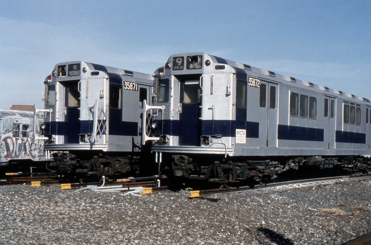 (235k, 1024x676)<br><b>Country:</b> United States<br><b>City:</b> New York<br><b>System:</b> New York City Transit<br><b>Location:</b> Coney Island Yard<br><b>Car:</b> R-14 (American Car & Foundry, 1949) 35871/35872 <br><b>Photo by:</b> Steve Zabel<br><b>Collection of:</b> Joe Testagrose<br><b>Date:</b> 12/22/1981<br><b>Notes:</b> Fire training cars.<br><b>Viewed (this week/total):</b> 5 / 7088