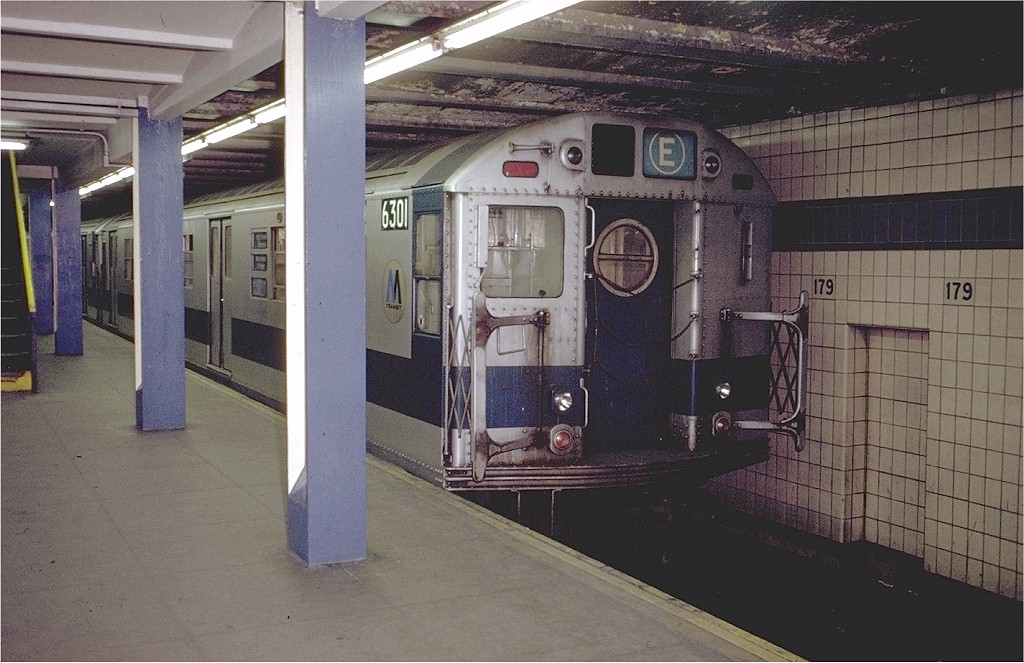 (200k, 1024x663)<br><b>Country:</b> United States<br><b>City:</b> New York<br><b>System:</b> New York City Transit<br><b>Line:</b> IND Queens Boulevard Line<br><b>Location:</b> 179th Street <br><b>Route:</b> E<br><b>Car:</b> R-16 (American Car & Foundry, 1955) 6301 <br><b>Photo by:</b> Doug Grotjahn<br><b>Collection of:</b> Joe Testagrose<br><b>Date:</b> 12/4/1971<br><b>Viewed (this week/total):</b> 2 / 5540