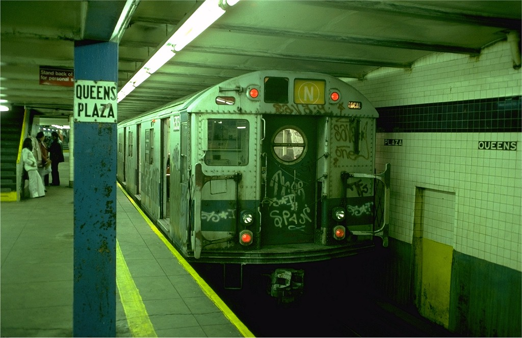 (173k, 1024x664)<br><b>Country:</b> United States<br><b>City:</b> New York<br><b>System:</b> New York City Transit<br><b>Line:</b> IND Queens Boulevard Line<br><b>Location:</b> Queens Plaza <br><b>Route:</b> N<br><b>Car:</b> R-16 (American Car & Foundry, 1955) 6303 <br><b>Photo by:</b> Doug Grotjahn<br><b>Collection of:</b> Joe Testagrose<br><b>Date:</b> 10/25/1976<br><b>Viewed (this week/total):</b> 5 / 5118