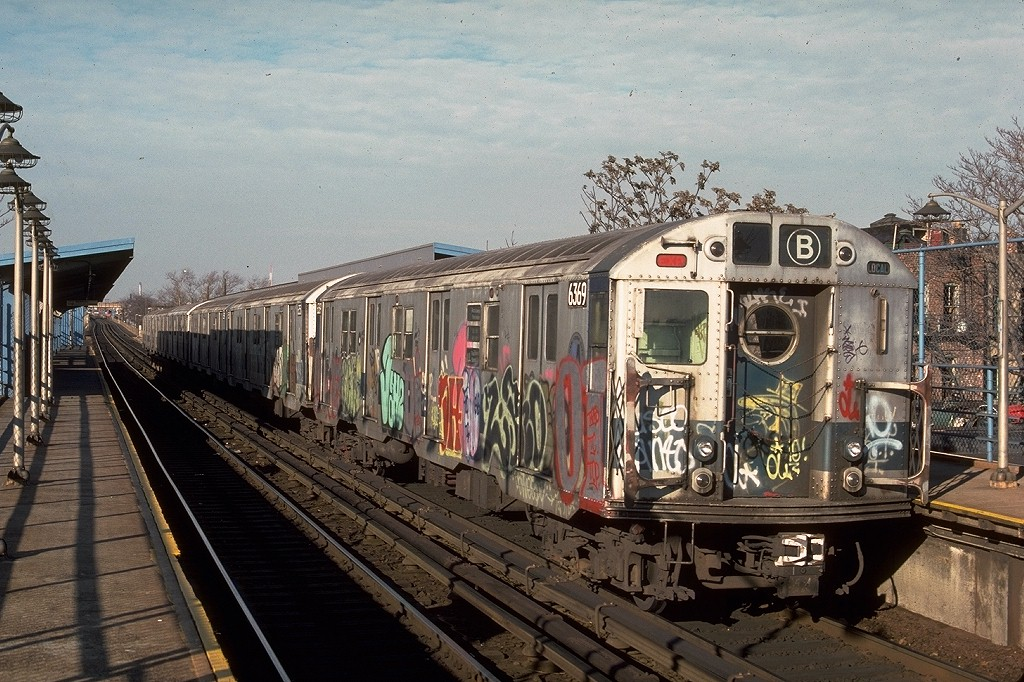 (245k, 1024x682)<br><b>Country:</b> United States<br><b>City:</b> New York<br><b>System:</b> New York City Transit<br><b>Line:</b> BMT Canarsie Line<br><b>Location:</b> New Lots Avenue <br><b>Route:</b> LL<br><b>Car:</b> R-16 (American Car & Foundry, 1955) 6369 <br><b>Photo by:</b> Ed McKernan<br><b>Collection of:</b> Joe Testagrose<br><b>Date:</b> 12/22/1976<br><b>Notes:</b> Note wrong route sign.<br><b>Viewed (this week/total):</b> 4 / 5585