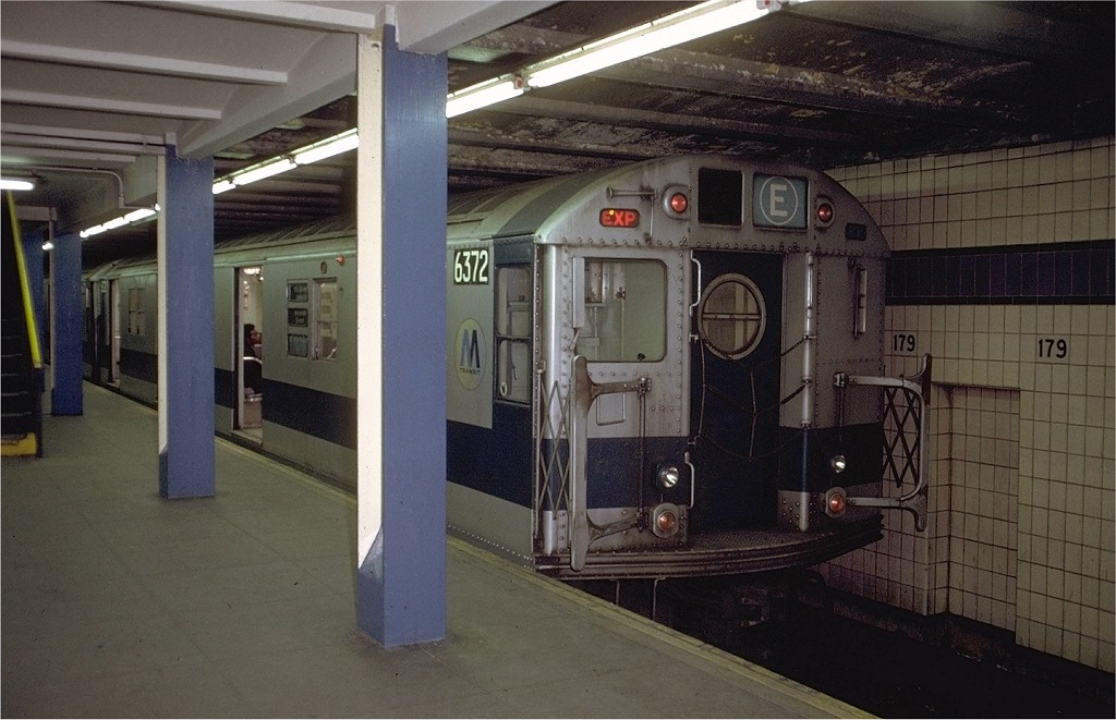 (173k, 1024x661)<br><b>Country:</b> United States<br><b>City:</b> New York<br><b>System:</b> New York City Transit<br><b>Line:</b> IND Queens Boulevard Line<br><b>Location:</b> 179th Street <br><b>Route:</b> E<br><b>Car:</b> R-16 (American Car & Foundry, 1955) 6372 <br><b>Photo by:</b> Doug Grotjahn<br><b>Collection of:</b> Joe Testagrose<br><b>Date:</b> 12/4/1971<br><b>Viewed (this week/total):</b> 3 / 2981